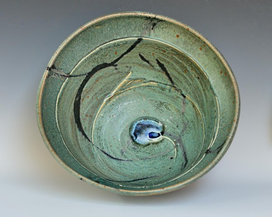 """Jeffrey Kirk's """"Creation Bowl,"""" 16 in by 16 in by 16 in, high-fired in a reduction atmosphere at cone 10"""