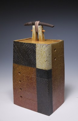 """Michael Poness' """"The Promise"""" is wheel thrown and altered, fired in a gas reduction kiln with soda ash (sodium carbonate) introduced into the kiln at cone 9. Firing continues until cone10. This piece has black slip and flashing slip."""