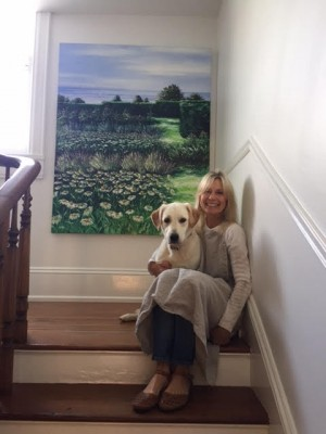 "Howard's ""Seaside Garden"" hangs on the wall behind the artist and her dog Rosie. Photo Credit: Frank Howard"