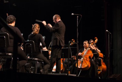 WMGSO Music Director Nigel Horne conducts the orchestra and chorus at its spring 2015 performance at F. Scott Fitzgerald Theatre in Rockville.