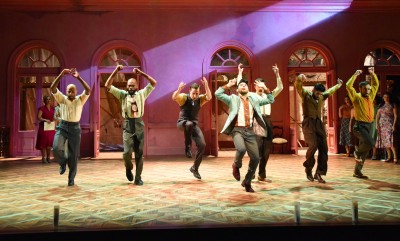"""Choreography—and the ensemble—plays a huge role in Olney's production of """"Evita."""""""