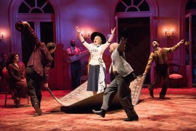 "The ensemble interacts with Rachel Zampelli as Eva Peron in ""Evita."""