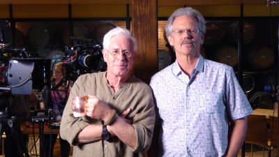 "Canadian singer-songwriter and musician Bruce Cockburn, left, appears in the documentary, ""Feast Your Ears-The Story of WHFS 102.3 FM,"" directed by Jay Schlossberg, right."