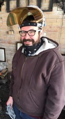 J. Chris Landers at the wood kiln.