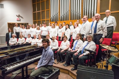 Daniel Hopkins, at the piano, was the Gaithersburg Chorus' accompanist in June while Cory Davis, at the far left in a suit, served as choral director.
