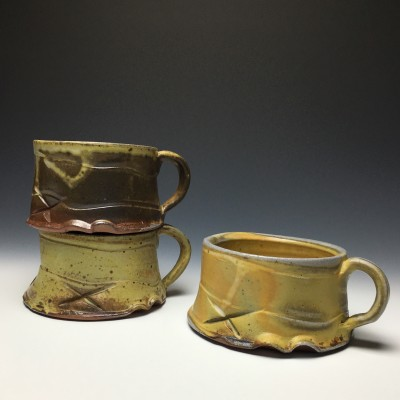 Chris Landers' wood-fired mugs were made in Rockville and fired offsite in a wood-burning kiln. This special kiln yields very natural surfaces by using wood as a fuel source and firing over a long duration of time and to an extremely high temperature.