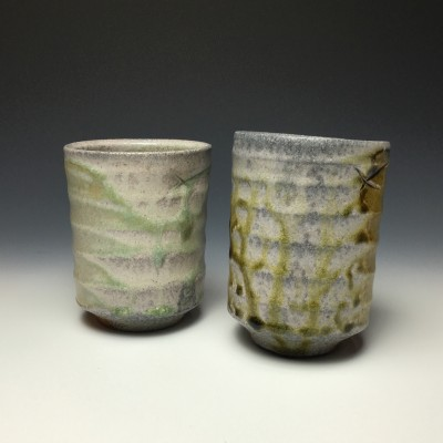Chris Landers often makes yunomi, Japanese tea cups that are used for casual tea consumption. Fired in a wood-burning kiln, he makes them in sets called meoto, representing a married couple.