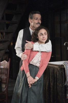 "A father's love: Carolyn Faye Kramer as Anne Frank and Paul Morella as Otto Frank in Olney Theatre Center's production of ""The Diary of Anne Frank."""