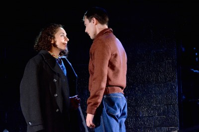 "Wartime romance: Carolyn Faye Kramer as Anne Frank and Alex Alferov as Peter van Daan in Olney Theatre Center's ""The Diary of Anne Frank."""