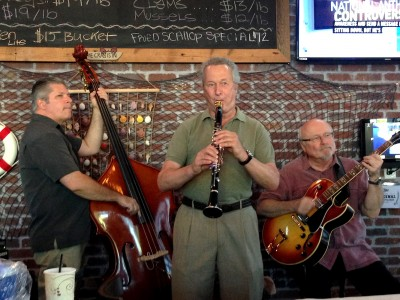 Members of the Greg Harrison Jazz Band--from left, Jay Miles on bass, Greg Harrison on clarinet, and Rick Rowe on guitar—at a local gig.