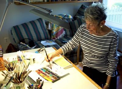 Watercolor artist Helene Glass works in her home studio.