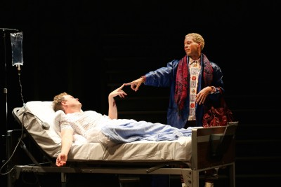 "Tom Story (as Prior Walter) and Jon Hudson Odom (Belize) in the Round House Theatre and Olney Theatre Center production of ""Angels in America Part I: Millennium Approaches."""