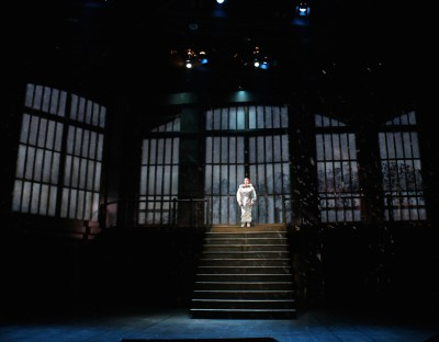 "Caption: Kimberly Gilbert (as Harper Pitt) in the Round House Theatre and Olney Theatre Center production of ""Angels in America Part I: Millennium Approaches."""