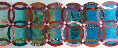 "Lauren Kingsland's ""Rings"" is part of the ""Quilted Mementos"" project. That project and 15 other pieces of her work will be on display at the Takoma Park Municipal Gallery from Sept. 8 to Nov. 2, with a reception on Sept. 8, 6:30 to 8 p.m."