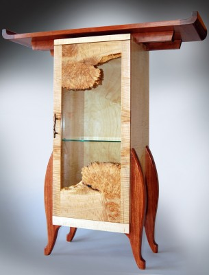 Jeffrey Oh's tall display cabinet, curly maple, maple burl and bubinga, 14 by 40 by 45 inches.