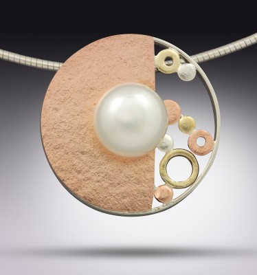 "Terry Pool's ""Bubble,"" 14K rose gold, 18K yellow gold, sterling silver, pearl, 1 inch."