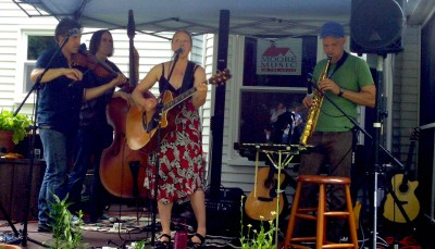 Colorado singer-songwriter Teresa Storch, backed by fellow singer-songwriters Joe Crookston, Jason Rafalak and Brad Yoder, perform at Scott and Paula Moore'sJune 2015 outdoor show.