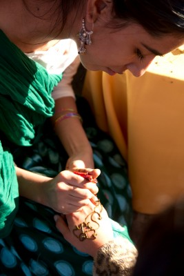 A woman applies henna to a hand at the World of Montgomery.