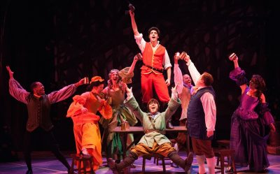 The taverncrowd sings their praises to Gaston. (L-R: Ian Anthony Coleman, Sarah Anne Sillers, Maggie Robertson, Tiziano D'Affuso, David Landstrom, Jobari Parker-Namdar, Matt Dewberry, Rachel Zampelli)