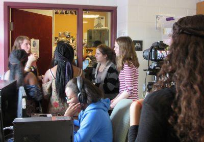4SW club members discuss lyrics.