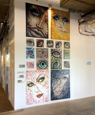 An artist's display at Artomatic Park Potomac.