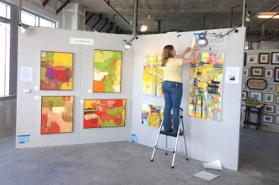 An artist installing her work at Artomatic.