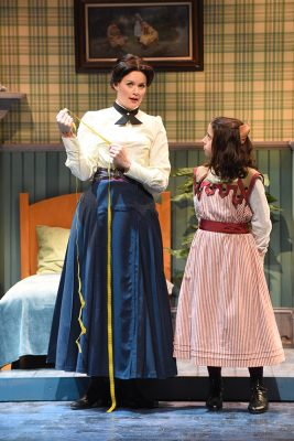 """""""Practically Perfect"""" Mary Poppins (Patricia Hurley) sizes up Jane Banks (Katharine Ford)."""