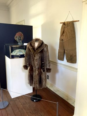A Sears tomboy coat made of possum and raccoon tails as well as a football helmet and pants are featured in the exhibit.