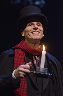 "God bless us, every one: Paul Morella as Ebenezer Scrooge (and 50 other characters) in Olney's ""A Christmas Carol."""