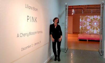 "Liliane Blom at the entrance to her exhibit, ""Pink – A Cherry Blossom Fantasy,"" at VisArts in Rockville."