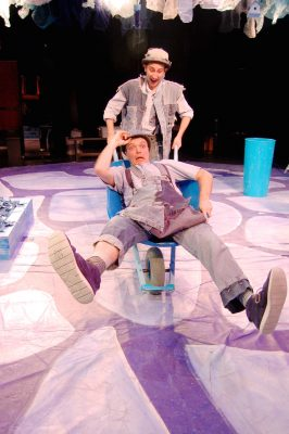 Inky (Noah Schaefer) knocks Pale (Jack Novak) into his wheelbarrow.