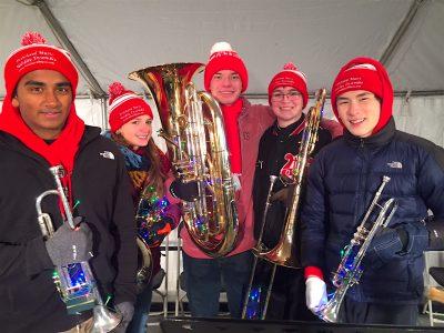 : juniors Jason McFadden and Arjun Guthal on trumpet, Kristen Gottlieb on horn, Chris Hunter on trombone, and senior Alex Loane on tuba