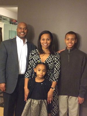 Laura Anderson Wright, her husband Darien, and their children, Kendall and Kennedy.