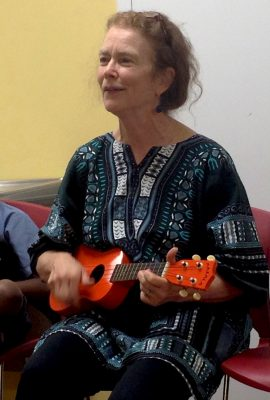Teacher, artist, activist, honoree Busy Graham, plays an orange uke.