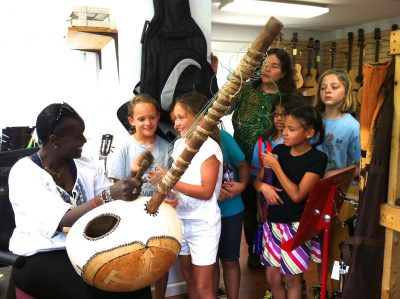 Artist Fatou Coulibaly with Carpe Diem Arts' French Immersion campers on a field trip to the House of Musical Traditions.