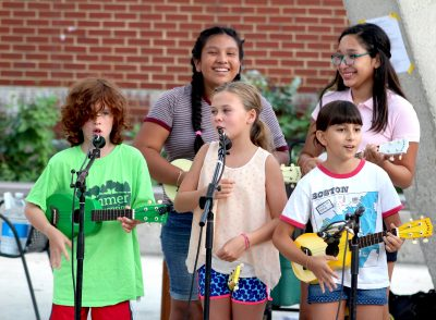 Campers perform in a Ukes on the Move! Carpe Diem Arts Spanish Immersion program.