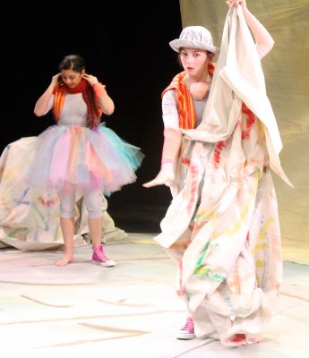 The dancers, Sara Herrera, left, and Anna Lynch, discover their wastebasket paper world.