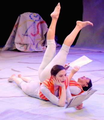 The dancers, Anna Lynch, left, and Sara Herrera, read their paper books in their paper world.