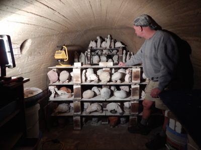 Mary Bowron's longtime assistant Robert Kelly inside the kiln.