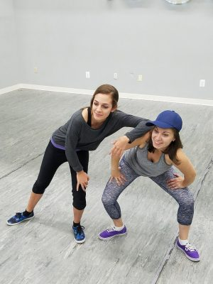 From left, Janet Palmer and Amanda Mendez rehearse their roles as narrator-storyteller-rappers.