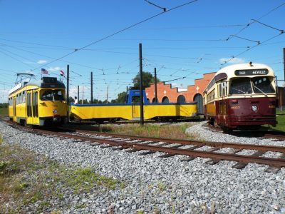 A Dutch tram, an English tram and a Canadian street car meet along the museum's demonstration railway.
