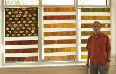 "Marc Robarge created ""This Land,"" an American flag image made from rubbings of surfaces such as tree bark."