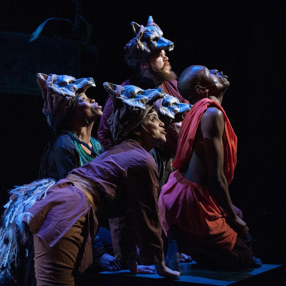 Mowgli (Justin Weaks) howls at the moon with his wolf family, from left, (Nora Achrati, Ryan Andrew Mitchell, Ricardo Frederick Evans.