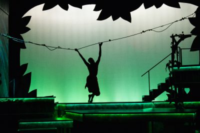 "Mowgli (Justin Weaks) swings through the tops of the trees of the jungle in ""The Jungle Book"" at Imagination Stage."