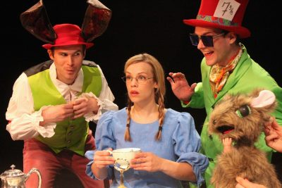 The March Hare, Mad Hatter and Dormouse treat Alice to a wacky tea party. From left, Matthew Schleigh, Erin Weaver, Matthew Ward, Daven Ralston.