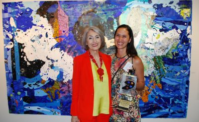 "Carol Trawick and first-place winner Katherine Tzu-Lan Mann pose in front of Mann's work, ""Spaniel,"" at the Bethesda Painting Awards Ceremony, June 7, 2017."