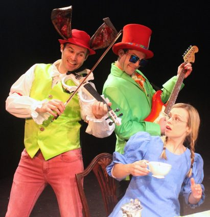 The March Hare and the Mad Hatter startle Alice with a surprise musical performance. From left, Matthew Schleigh, Matthew Ward, Erin Weaver, Daven Ralston.