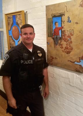 Officer John Duke at the Arts Barn exhibit.