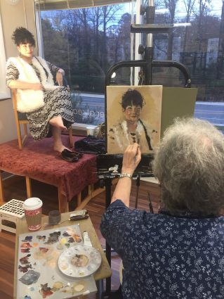 Painting from life: Kathleen Carroll paints the model Shadiyah.