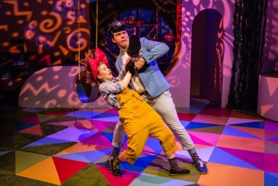 Megan Graves as Junie B. Jones and Elliot Kashner as the policeman